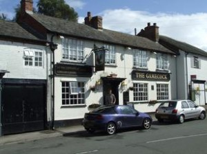 Picture of Gamecock Inn Harbury, white building
